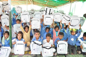 Children at the Pehli Kiran School run by the JAQ trust with Mobilink Billboard Bags